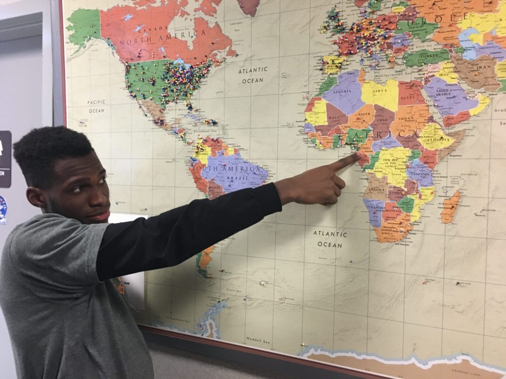 Jeff Pointing at Cameroon on a Large Wall Map